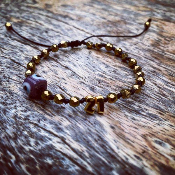 lucy charm 21 Gold Hematite red Murano Evil Eye